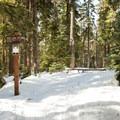 The Enid Lake Loop shares a segment with the Glacier View Loop.- Enid Lake Ski + Snowshoe Loop Trail