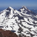 From the South Sister's summit, looking north toward the Middle Sister (10,047'), the North Sister (10,085'), Mount Jefferson (10,495') and Mount Hood (11,250').- Three Sisters Wilderness