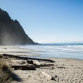 The trail emerges onto the beach with southern views of Heceta Head.- Hobbit Trail