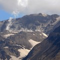 Steam rising from the Mount St. Helens caldera and the ever growing central dome.- Mount St. Helens National Volcanic Monument