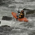 A boater launches off of Toby's rapid at the end of the run.- Canyon Creek