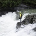 A kayaker sets safety at Thrasher, a ledge hole in the top half of the run.- Canyon Creek