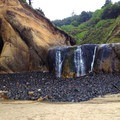Seasonal waterfall during low tide in the cove.- Hug Point State Recreation Site