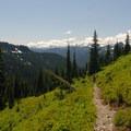 View looking west toward the Tatoosh Range.- Dewey + Anderson Lakes