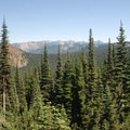 View looking east into the Wenatchee National Forest.- Dewey + Anderson Lakes