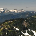 View west toward the Tatoosh Range and Unicorn Peak (6,917').- Dewey + Anderson Lakes