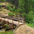 A PCT footbridge over Squaw Valley Creek.- Cabin Creek Campsites