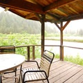 View from the covered deck overlooking the fishing pond.- Friday's Pond House