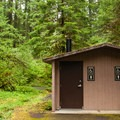 Vault toilets on the lower level.  The solar panels power a flood alert system.- Olallie Campground