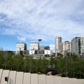 View to PACCAR Pavilion with the Space Needle in the distance.- Olympic Sculpture Park