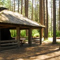 Pine Rest Campground's Civilian Conservation Corps picnic shelter.- Pine Rest Campground