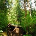 Vault toilet facilities.- Rainbow Campground