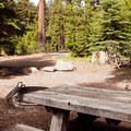Picnic tables and campfire grills at each site.- Fifteen Mile Campground