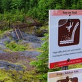Cautionary signs on the path to the Lava Canyon waterfall viewpoint.- Lava Canyon