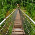 Crossing the suspension bridge.- Lava Canyon