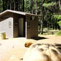 Hoodoo Recreation Services keeps the vaulted toilet facilities clean.- Candle Creek Campground