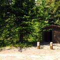 Vault toilet facilities at Cat Creek Campsites.- Cat Creek Campground + Campsites