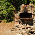 Old fireplace structure at Cat Creek Campsites.- Cat Creek Campground + Campsites