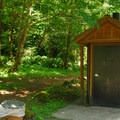 Vault toilet facilities.- Blue Lake Creek Campground