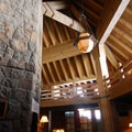 Timberline Lodge's central hearth room illuminated by winters reflective snow.- Timberline Lodge