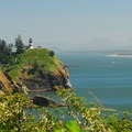 Cape Disappointment Lighthouse and Saddle Mountain (3,288 ft.) from McKenzie Head.- McKenzie + North Head Hiking Trails