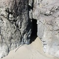 "A large cave with a ""window"" at Whaleshead Beach.- Whaleshead Beach"