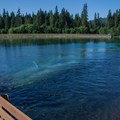 Fishing from the bridge over the McKenzie River.- Carmen Diversion Reservoir