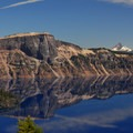 View of Llao Rock and Mount Theilsen (9,182').- Crater Lake National Park