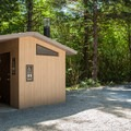 Vault toilets at Three Bears Recreation Site.- Three Bears Recreation Site