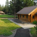 View of the log cabin meeting hall in the South Loop.- LaPine State Park Campground