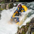 Rafters use a unique method to get down and hold on during runs over Husum Falls.  - Middle White Salmon River