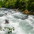 Kayakers paddle into Grasshopper rapid at low flows.- Middle White Salmon River