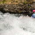 A kayaker emerges after going deep at Waterspout.- Middle White Salmon River