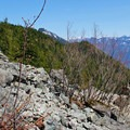 Near Haystack Basin, the trail becomes rockier and less shaded.- Mount Si Hike