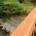 A bridge over the creek near campsite 18.- Squaw Lakes Campground