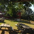 A view of the visitor center from the Manson Barn.- Champoeg State Park