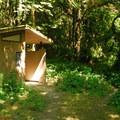 Vault toilet facilities at Packsaddle County Park.- Packsaddle County Park