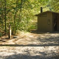 One of three vault toilet facilities at Santiam Flats Campground.- Detroit Lake, Santiam Flats Campground