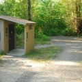 Vault toilet facilities near the boat ramp.- Detroit Lake, Hoover Campground