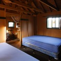 Cabin 6 interior with two queen-sized beds.- Olallie Lake Resort