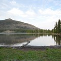 Olallie Lake and Olallie Butte (7,215') from Camp Ten Campground.- Camp Ten Campground