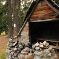 A rustic picnic pavilion at Breitenbush Lake Campground.- Breitenbush Lake Campground