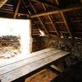 A rustic picnic pavilion at Breitenbush Lake Campground.- Breitenbush Lake Campground