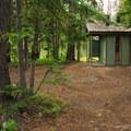Breitenbush Lake Campground vault toilet facility.- Breitenbush Lake Campground