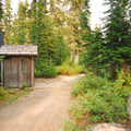 Horseshoe Lake Campground's vault toilet facility.- Horseshoe Lake Campground