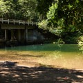 Dolly Varden Campground's main attraction, a great swimming hole and beach.- Dolly Varden Campground