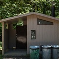 Vault toilets at Dolly Varden Campground.- Dolly Varden Campground