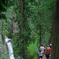 Several groups of hikers gather for a view of Toketee Falls.- Toketee Falls