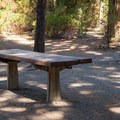 Counter, barbeque, and water are in each site.- Simax Group Campground