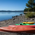 Canoe and kayak rentals on the sandy beach at Crescent Lake Resort.- Crescent Lake Resort